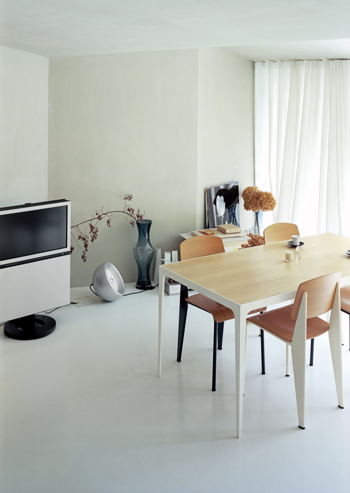 Architect Makoto Tanijiri's firm custom-designed most of the furniture in the building, including the steel-and-paulownia dining table.  Photo 2 of 11 in Small Space Live/Work Box Home in Japan