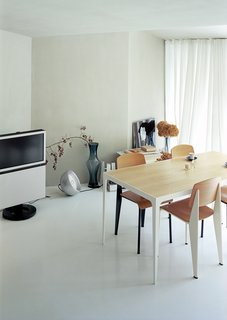 Small Space Live/Work Box Home in Japan - Photo 2 of 11 - Architect Makoto Tanijiri's firm custom-designed most of the furniture in the building, including the steel-and-paulownia dining table.