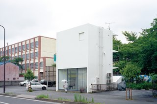 Small Space Live/Work Box Home in Japan - Photo 6 of 11 - The structure is an elegant riff on the boxy apartments and school that surround it.