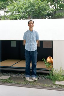 Small Space Live/Work Box Home in Japan - Photo 1 of 11 - Grown-up visitors have to hunch down to enter the teahouse and additional gallery space behind the building, but kids from the neighboring elementary school are able to slip right in to check out the art.
