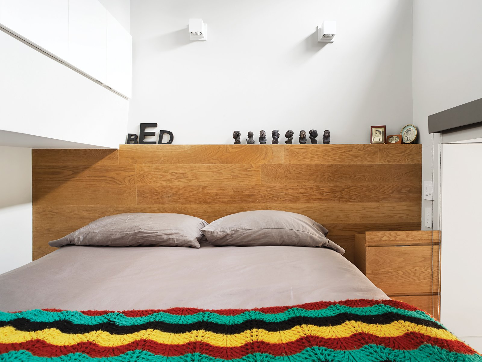 To maximize space, both sides of the bed are outfitted with wall sockets and reading lights. Tagged: Bedroom and Bed. The Manhattan Transformation - Photo 6 of 12
