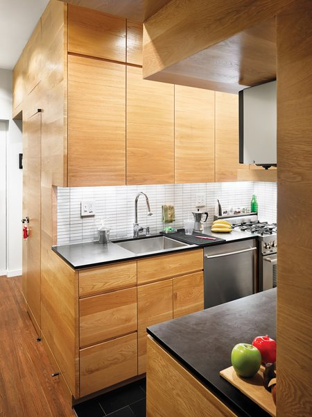 """The most important thing to do in a small space is exploratory demolition,"" Pozner says. ""We found all that height in the bathroom ceiling. There are giant cabinets above the bed—we found all that space. This facilitated architect Darrick Borowski's small-space rallying cry: ""Built-ins, built-ins, built-ins!"""