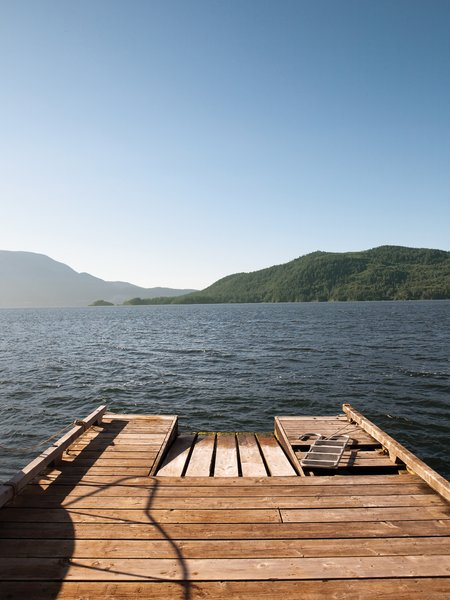 Down on the cedar dock, the view of nearby Bowen Island generates a dramatic foreground view, while the British Columbia mainland in the distance appears to be a world away.