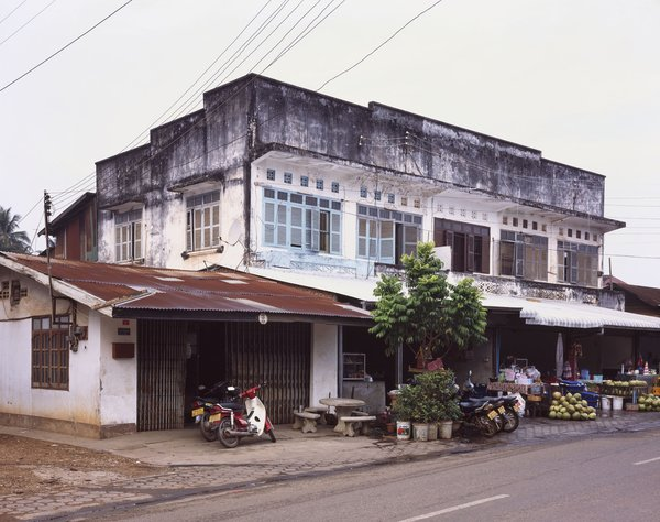 This building is fairly common in Vientiane, with the storefront at the bottom and living quarters in back and on top.