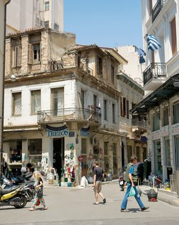 Traditional facades and considerable foot traffic are the norm in neighborhoods like Monastiraki.