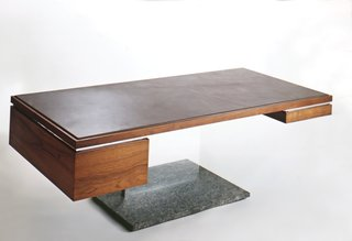 "A 500-pound executive status symbol? Yes, in the form of a $6,000 leather, wood, and bronze desk designed by Platner. ""I thought of these things as trees,"" he said."