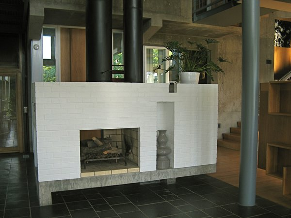 The hearth is central, and like the rest of the house, reassuring in its classism, in both proportion and assembly. While in a way austere, the richness of material keeps the house from feeling cold or operational. Still, it has to be understood as an exercise in Architecture for architectures sake, high couture, embracing certain abstract ideas of architecture and not necessarily a practical application in society.