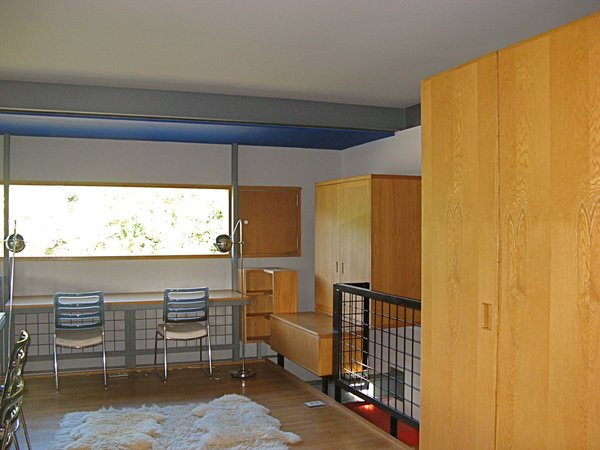 "A view of one of the boys' bedroom shows how the furniture was built into the wall and the relationship of walls to the floor, making clear, as Guyon has described, that this is really ""an experiment masquerading as a house."" As is indicative of a pure Modernist home, all glass is fixed, with separate screened compartments for ventilation. Circulation and places of repose are also separated. As one can see at the right of the frame, the box is denied, the cube explodes, things come apart and nothing directly touches. ""Its not egalitarian, its completely elite. Though many find it to be bare bones, its just really intense in its craft,"" says Guyon."