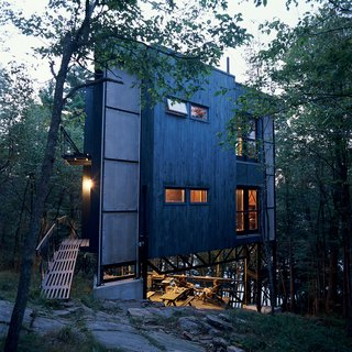 A Modern Dark Tower - Photo 3 of 5 - Playfully christened La Tour des Bébelles, the three-story, steel-framed tower has shown itself to be the ideal summer retreat: secluded, perfectly positioned near Ontario's Otter Lake, and encouraging of its inhabitants to spend time outdoors.