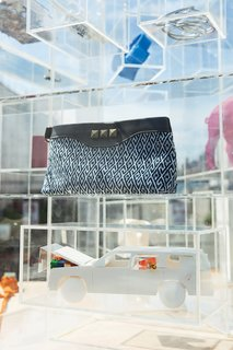 Text Appeal - Photo 4 of 20 - ViaPortal's Plexiglas shelves are purpose-built to show a changing collection: Miyakawa made this plastic model station wagon, and the Indigo Clutch by Article 22 was dyed and handwoven in Laos.