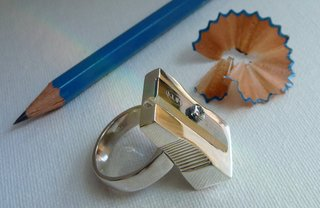 "Pencil Sharpener Ring by Monika Wyndham<br><br>($225.00 for one)<br><br>text ""MWRing"" to 767825 (portal)<br><br>""Over the summer I met Monika for the first time at a coffee shop in Brooklyn.  Among other things, I asked her to be in a show we were curating at the time for SoHO's Partners & Spade.  She said sure, and that she wanted to do a ring.  She had not only never cast anything before, but she also had just two months to whip something up.  What a champ.  When I finally saw the finished ring, I was floored that she was able to develop such a perfect piece in so little time.  These rings are fully functional, shiny silver and real heavy.  Monika is the type of artist that will be making very strong work for a very long time.  If you do purchase this ring, consider it an investment.  I have no doubt that its value will increase once the world takes notice of the killer stuff that pops out of this woman's head."""