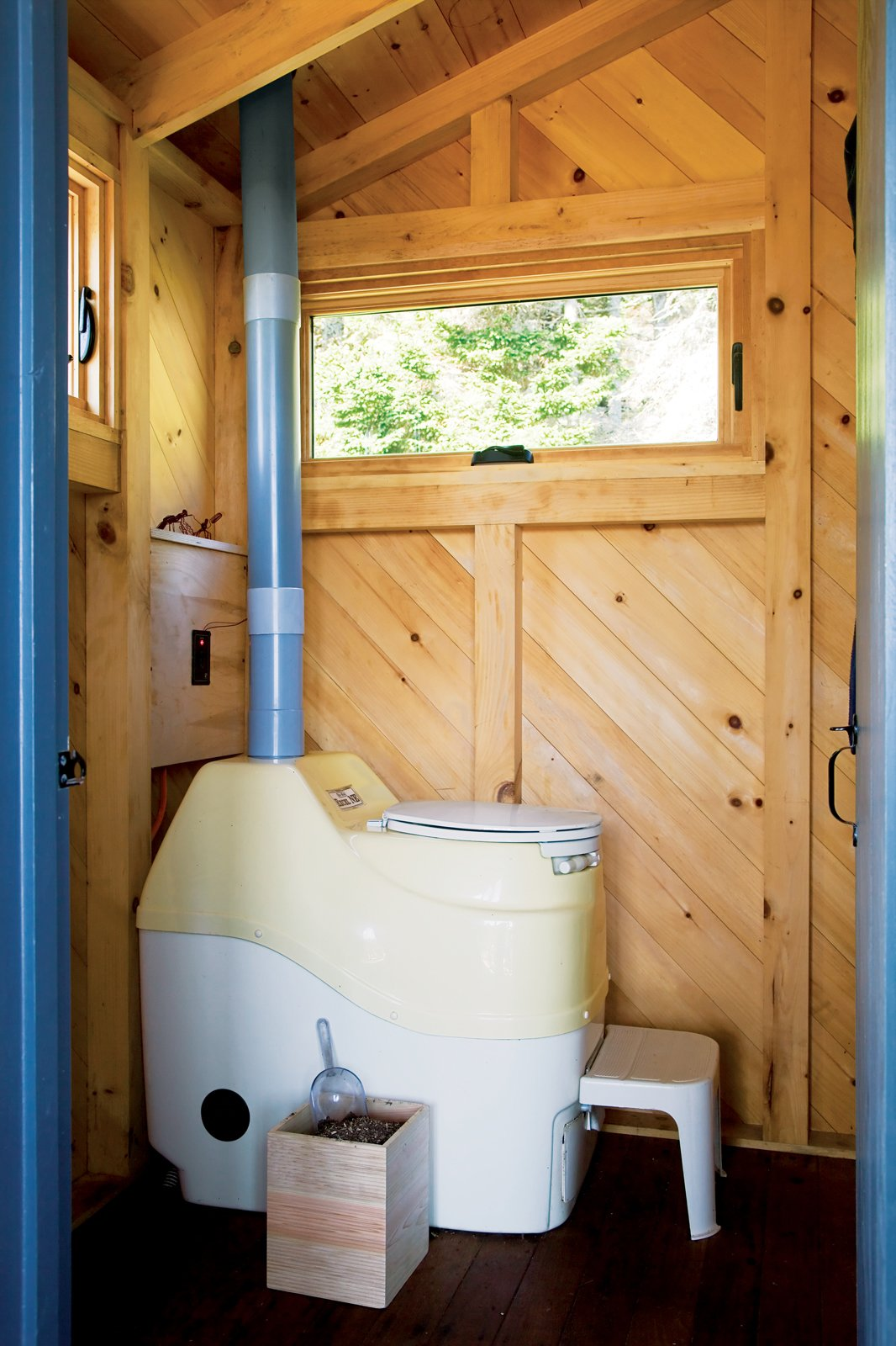 Since septic systems are impossibilities on Criehaven, the Porters chose a Sun-Mar self-contained composting toilet as the ideal alternative. Tagged: Bath Room and One Piece Toilet.  Photo 11 of 21 in A Tiny Cabin is This Writer's Off the Grid Getaway