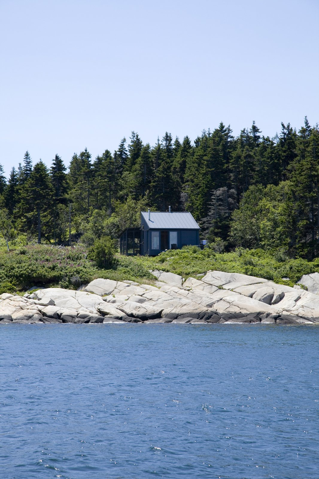 "One of the early challenges of building the house was defining the property lines of the lot, which had come to be known as ""the floating acre"" among the local fishermen. A Tiny Cabin is This Writer's Off the Grid Getaway - Photo 13 of 21"
