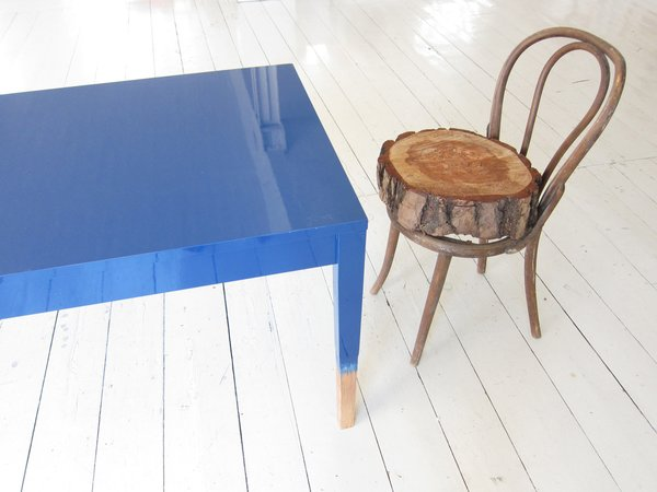 """Khemsurov: """"The blue table is a precursor to Trift, developed in 2008 for Milan's Post Design Gallery. The chair, however, is a kind of inside joke — Seng acquired the broken Thonet frame from her grandmother's house eight years ago, and Valder kept begging her to fix it or throw it out. The feud was resolved during the move in May, when someone rested one of Seng's stumps on the chair's seat by happenstance. """"Now we love it,"""" says Valder."""""""
