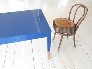 "Khemsurov: ""The blue table is a precursor to Trift, developed in 2008 for Milan's Post Design Gallery. The chair, however, is a kind of inside joke — Seng acquired the broken Thonet frame from her grandmother's house eight years ago, and Valder kept begging her to fix it or throw it out. The feud was resolved during the move in May, when someone rested one of Seng's stumps on the chair's seat by happenstance. ""Now we love it,"" says Valder."""