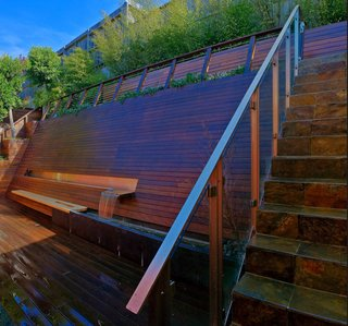 Landscape Architecture: Marcel Wilson - Photo 6 of 6 - For a steeply sloping backyard in San Francisco, he devised this all-in-one wooden wall, which provides seating, a fountain that helps block out highway noise, and, at the top of the steps, a lookout point that offers a view on the surrounding neighborhood.