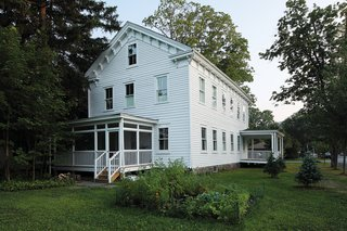 With its porches and rows of windows, the still-legible schoolhouse <br><br>is unwaveringly 19th century.
