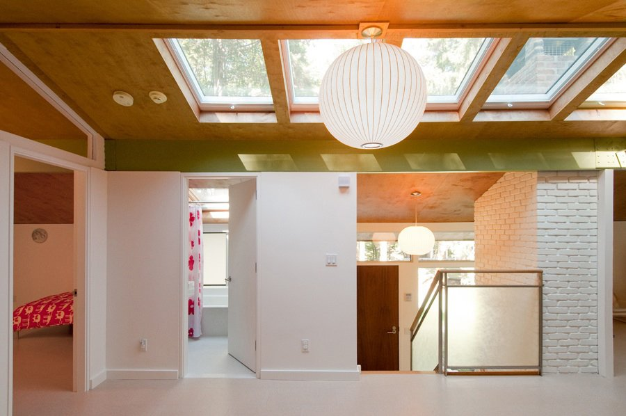 "The two twelve-by-sixteen-foot bedrooms, directly above a comparable pair on the first floor, feature a glass transom that follows the pitch of the roof. ""The stair and railings were very simple,"" Depardon observes. ""We added a bit of design, with panels made from frosted Japanese rice paper between layers of glass."" The architects created skylights and installed rooftop solar panels that heat the water and first-floor radiant system – changes Depardon considers faithful to Koch's philosophy of rationality and cost-effectiveness. ""The idea was, this is a great little piece of architecture – let's try to be respectful of it."" Show-Stealing Skylights in Modern Homes by Zachary Edelson"