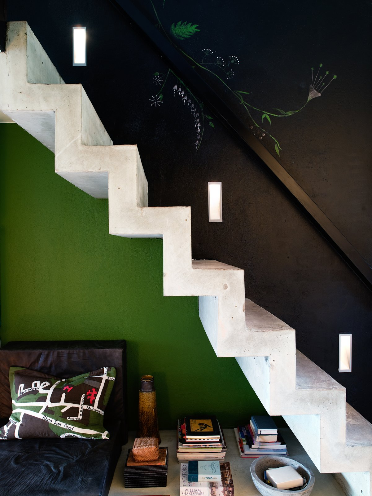 Concrete stairs lead up to the sleeping loft. Photo by Per Magnus Persson. Tiny Homes  by Erika Heet