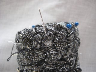 7. Using a needle and thread, stitch between each row. Remove the pins when complete.