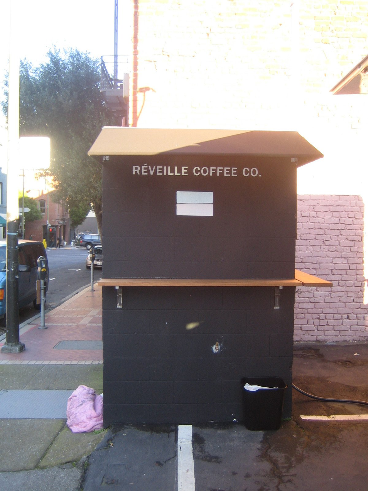 A rare thing indeed: a food cart with a tiny bit of physical infrastructure. Tommy said that during the summer he and his brother are thinking about painting the shed white. Réveille Coffee Company Truck - Photo 6 of 8
