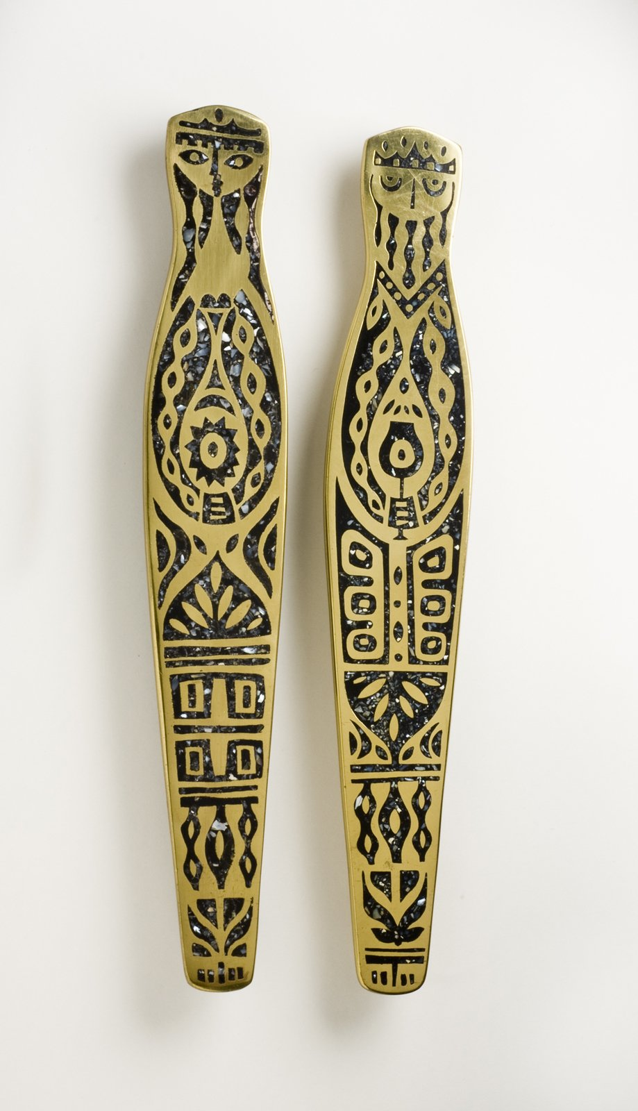 King and Queen Door Pulls, hand-cast brass with black mother-of-pearl inlay, Evelyn Ackerman, 1959.  A Marriage of Craft and Design by Miyoko Ohtake