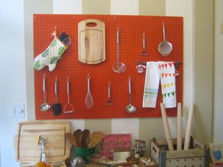 Wageman takes a cue from Julia Child with her cheerful pegboard organizer.