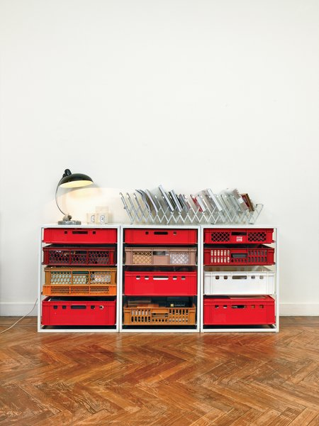 At home, Högner still uses the prototype for her colorful All for One shelves to file papers and magazines.
