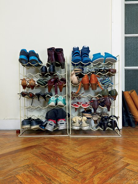 In the entryway, wine racks are reborn as a place to keep shoes.