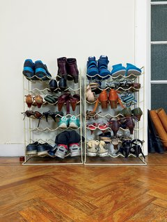 Kind of New - Photo 8 of 15 - In the entryway, wine racks are reborn as a place to keep shoes.