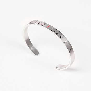 "Craig Arnold's upcycled ""Aperture Cuff"" can be purchased at oyemodern.com."