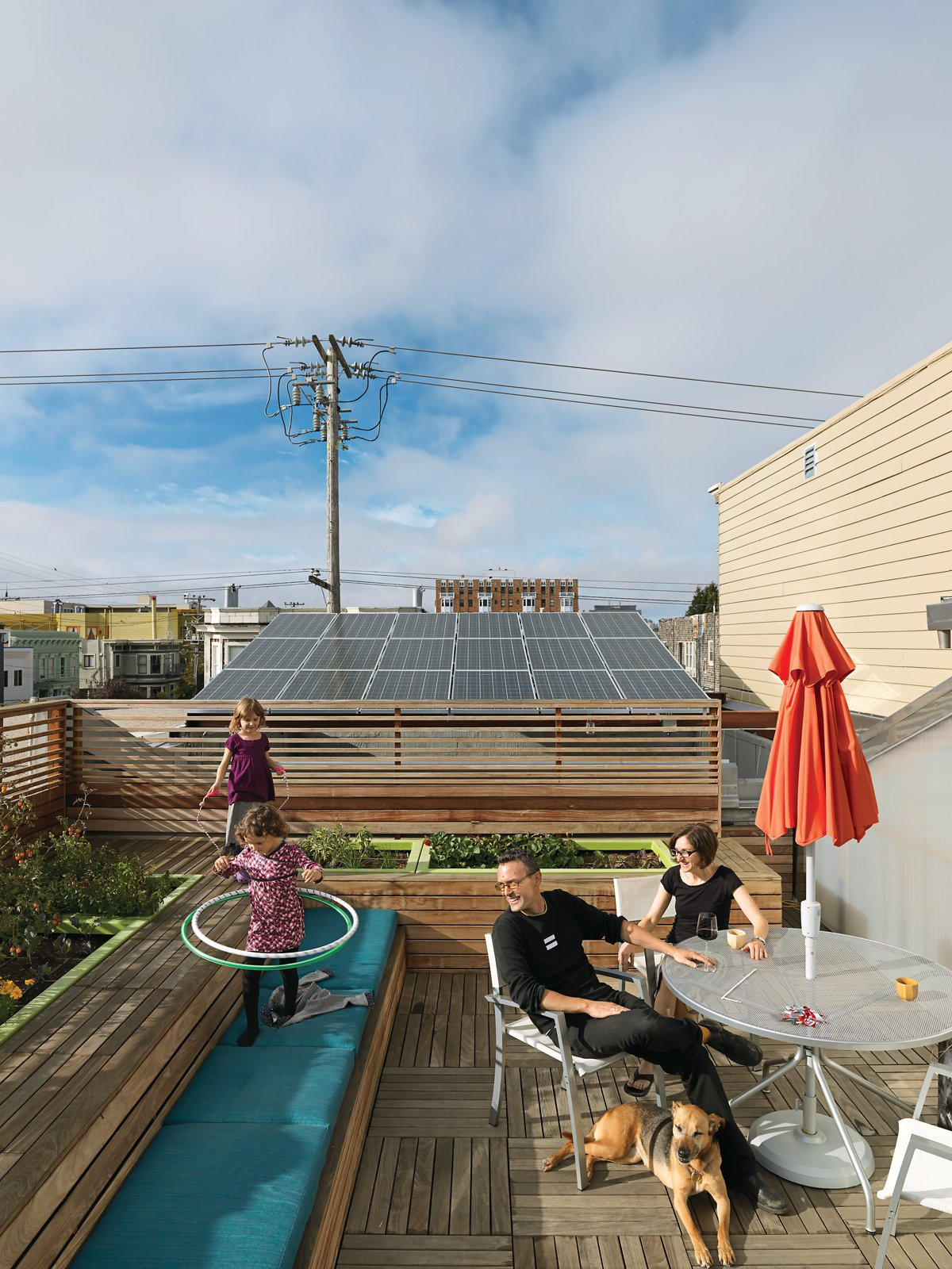 The roof became the perfect location for their vegetable garden, as well as benches and a recreation space crowned by a hot tub powered by a four-kilowatt solar array. Tagged: Outdoor, Rooftop, Wood Patio, Porch, Deck, Vegetables, Horizontal Fences, Wall, Gardens, Decking Patio, Porch, Deck, and Wood Fences, Wall.  Private Rooftop Sanctuaries  by Zachary Edelson from Just Redo It