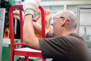 Emeco's 111 Navy Chair - Photo 7 of 13 - A worker smoothes any imperfections before manually installing the H-brace.