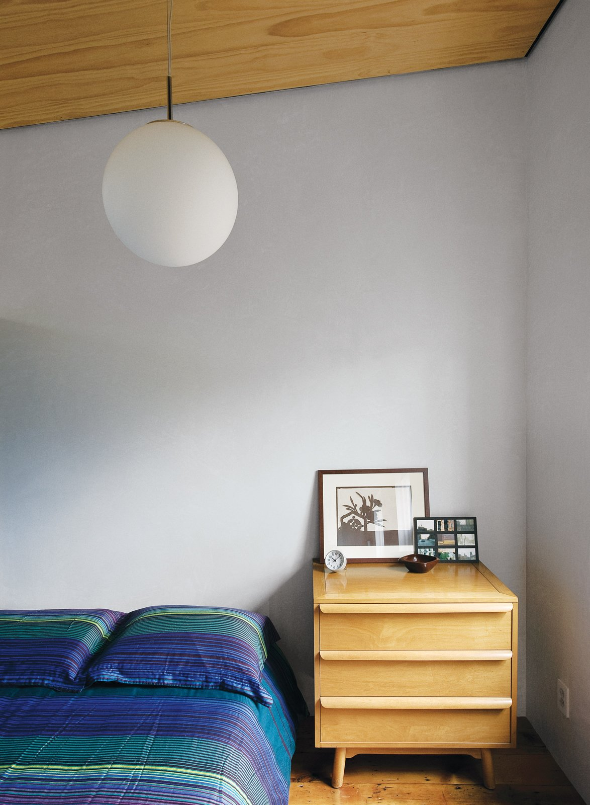Lange's predilection for vintage design punctuates the space. The office level includes a cozy guest room with a mid-century Heywood Wakefield-esque dresser serving as a bedside table.  Photo 11 of 28 in Family Home Renovation in Brooklyn