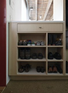 Family Home Renovation in Brooklyn - Photo 15 of 28 - By the door, shoes get organized on a built-in by JKK Woodcraft.
