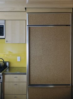Family Home Renovation in Brooklyn - Photo 16 of 28 - A fridge clad in cork provides a decidedly warm touch to the kitchen.