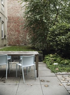Family Home Renovation in Brooklyn - Photo 20 of 28 - A quartet of Jasper Morrison Air Chairs for Magis provide outdoor seating.