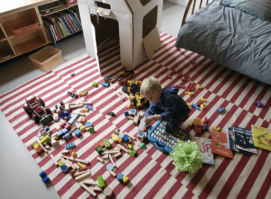 Paul spreads out his toys on a rug from Pottery Barn. Tagged: Kids Room and Bedroom.  Photo 23 of 28 in Family Home Renovation in Brooklyn