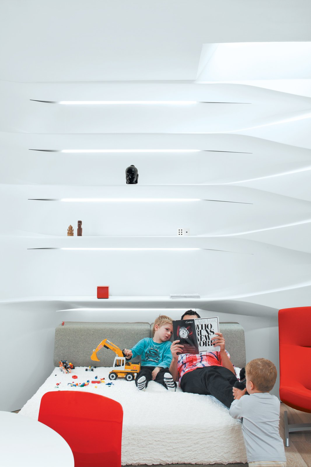 """The bed, usually scattered with Legos and toy cars, """"is a big playground for the kids,"""" says Krastev."""