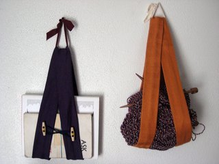 Anything goes! Sling away! Here's the purple guy with an orange one I made over the holidays. I tossed my knitting in there (it worked because those skeins are pretty hefty), but you could just as easily stash a notepad, incoming/outgoing mail, magazines.... you name it. Have fun!