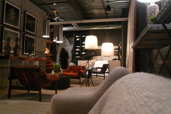 The 8,500-square-foot interior is filled with an eclectic mix of industrial, modern, and antique furniture.