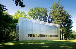 The Salt Point House (2007) is a two-bedroom cedar box cloaked in a perforated  and corrugated stainless-steel screen. It's set on a wooded, nine-acre parcel in New York's Hudson Valley.