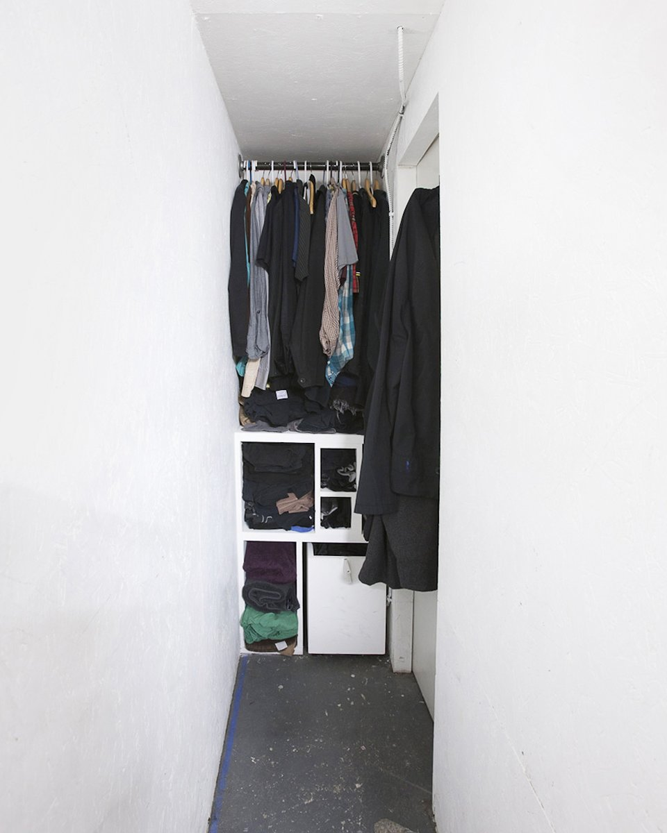 Every leftover space was put to use. Here, a narrow slot behind the structure allows just enough room for a tight walk-in closet. Communal Living on a Budget in Brooklyn - Photo 10 of 13