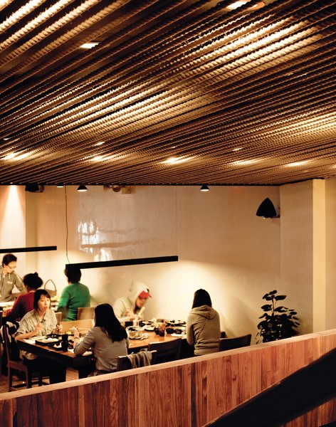 With its orderly rope-covered ceiling and sleek bars of light, Minnis Shabu Shabu, John Hsu's restaurant, is purposely at odds with Flushing's aesthetic.