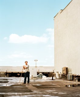 Five Boroughs in 48 Hours - Photo 18 of 32 - Cinematographer Wilmot Kidd sweeps the roof of the Red Hook industrial building that contains his home.