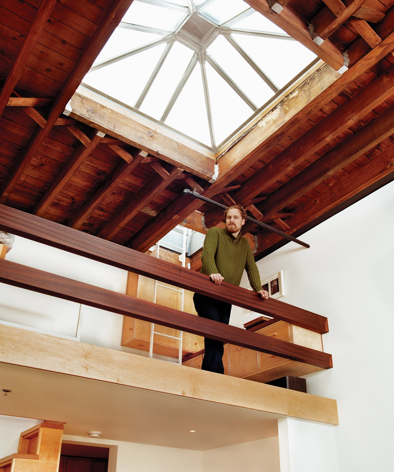 The sleeping loft is fitted with mahogany rails.  Clever Loft Spaces for Small Places by Diana Budds from Brooklyn