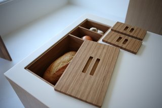 Viola Park's New Kitchen Islands - Photo 3 of 5 - Make that bread box and bread bin. These In-Counter Storage Modules also help keep the prep area clear.