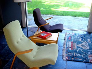 "These Saarinen Grasshopper chairs were recently reupholstered with Knoll fabrics. The bent plywood nesting table between the chairs was designed by Breuer in 1935, is currently produced by Isokon in London, and was the first furnishing purchased for the restoration. ""We used Ezra Stoller's period photography and the registrar's list from MoMA to see what was originally in the house,"" says Cynthia Altman, Kykuit's Senior Curator. ""Luckily because mid-century has become so popular these days pieces are being reissued."" Photo by Diana Budds."