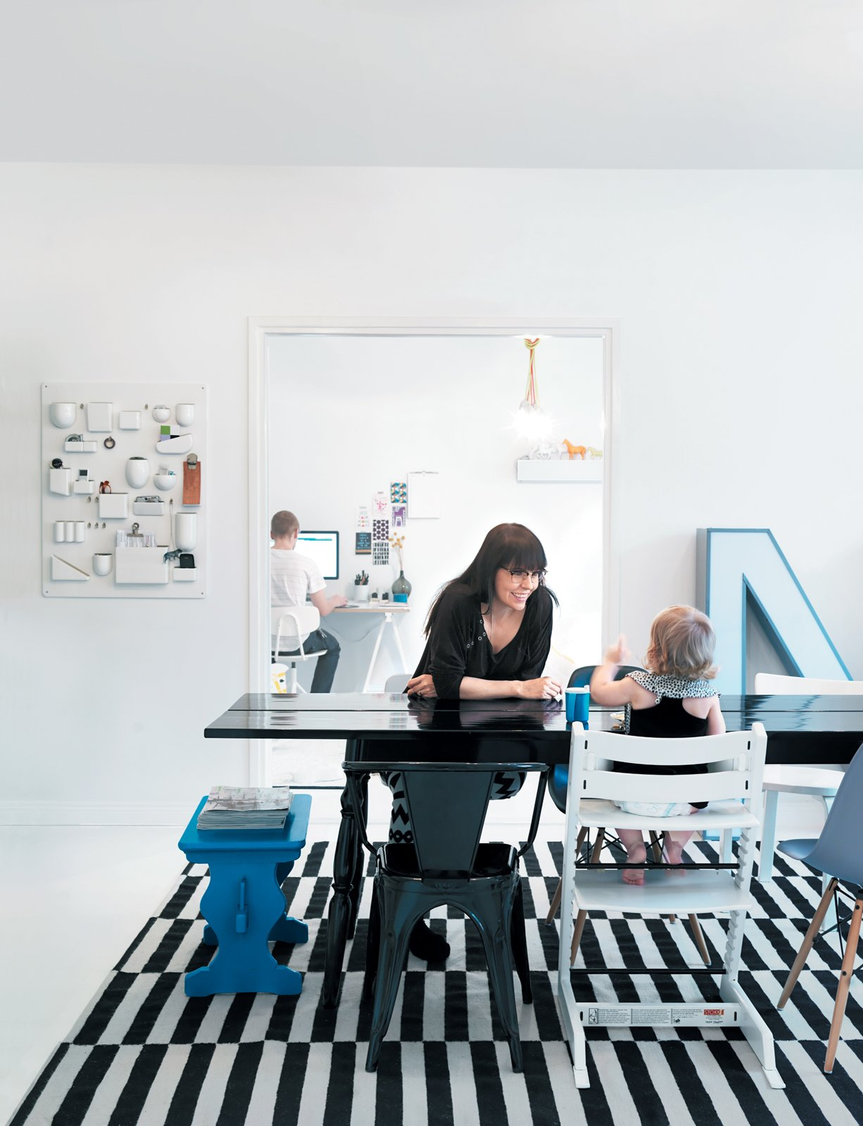 """Susanna Vento, pictured here with her daughter Varpu, is a Helsinki-based editor, stylist, and interior designer. Asked about her design approach in her own apartment, she says: """"As an interior designer I choose new designs for my clients, but for my own home, I tend to prefer crafty or old stuff. If I buy something, I want to buy only things that stand the test of time. But even better is to buy nothing at all and do-it-yourself!"""" Tagged: Dining Room, Chair, and Table.  Photo 1 of 16 in Fine Finnish"""