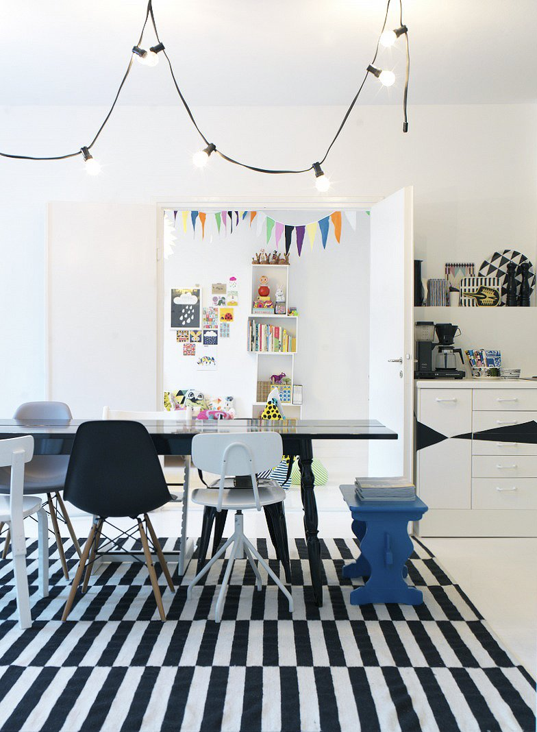 The family's activity centers around the open-plan dining room, which does triple-duty as a living room and kitchen. Susanna prefers a motley set of dining chairs over a coordinated set; that way guests can pick their favorite when they sit. Fine Finnish - Photo 2 of 16